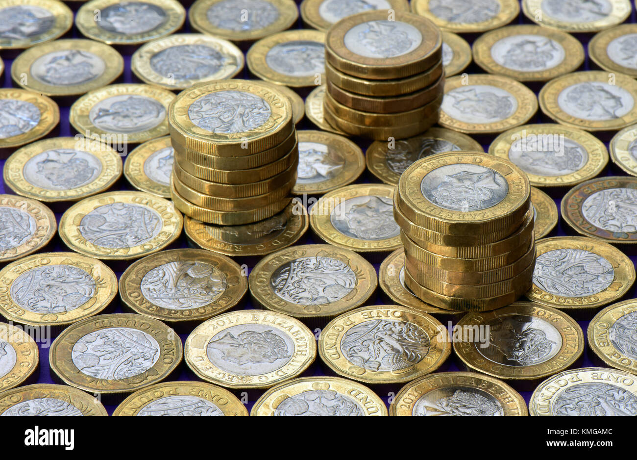 A great number or lot of new one pound coins covering a