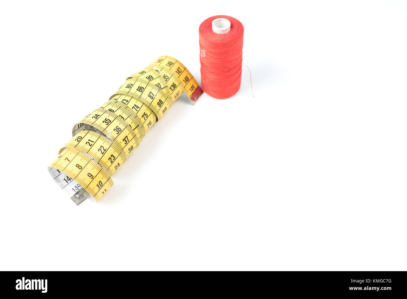Yellow sewing measuring tape on white background - Stock Image