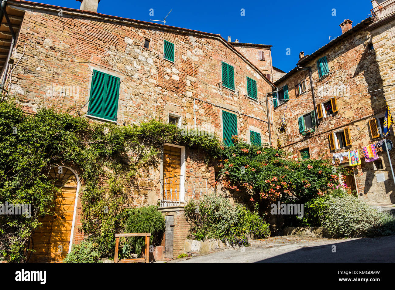 Typical, characteristic stone house with green shutters located in Montepulciano, Tuscany Italy. - Stock Image