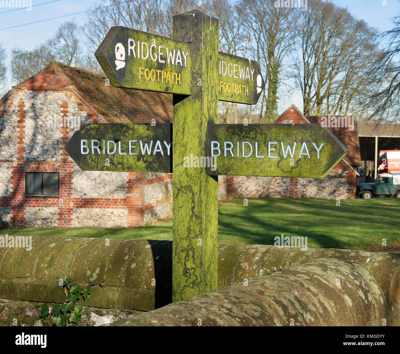 Wooden footpath and bridleway signpost - Stock Image