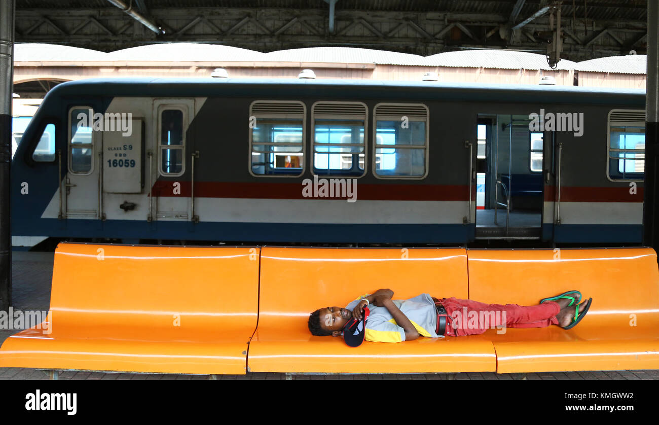 A Passeneger deep sleep on the passenger bench during the railway locomotive operating Engineers union strike in - Stock Image