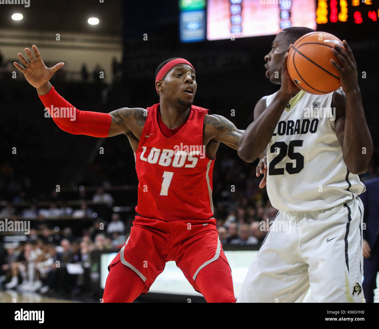 December 06, 2017: New Mexico's Chris McNeal guards Colorado's McKinley Wright in the second half at the Coors Events Stock Photo