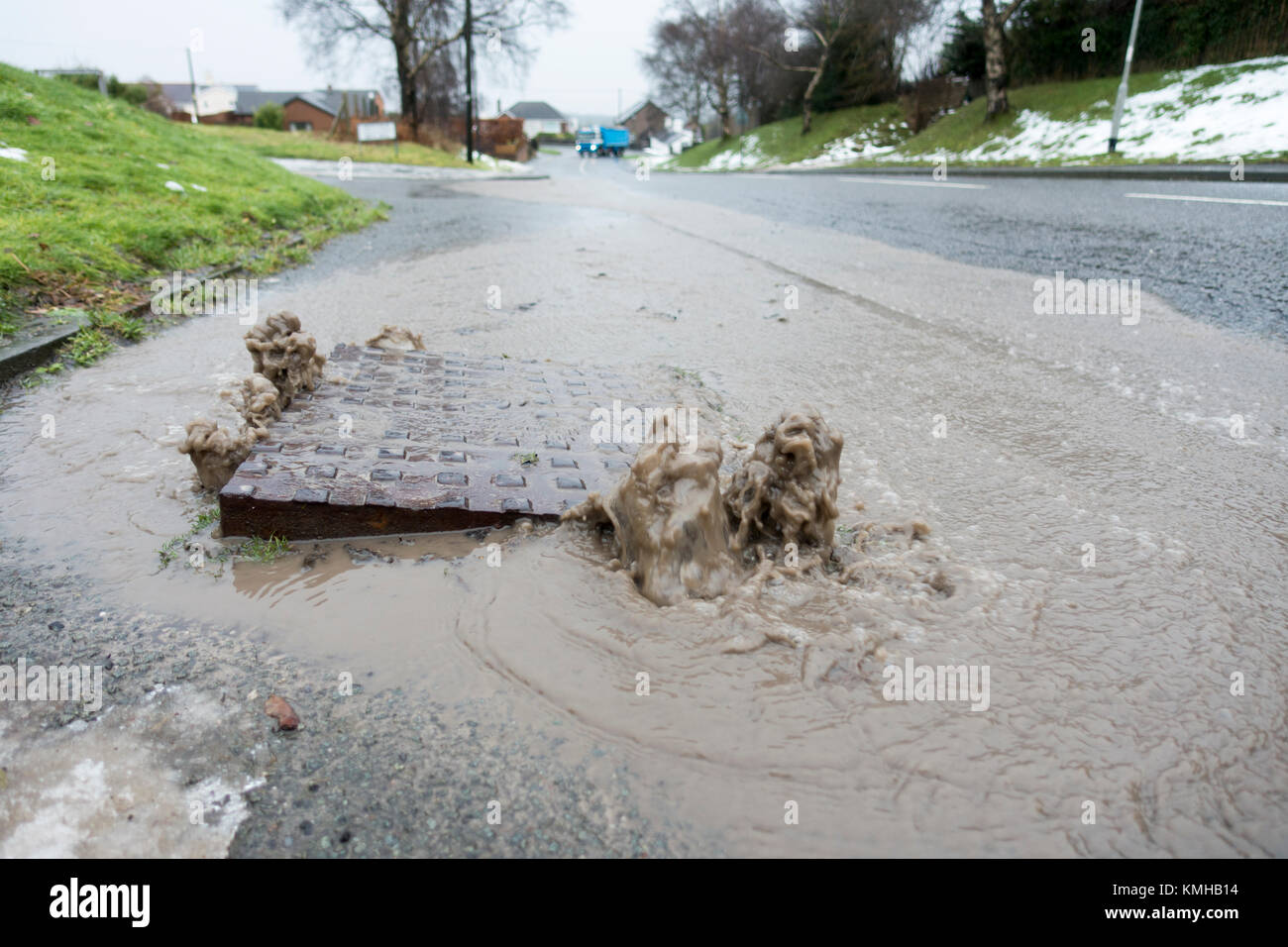Flintshire, UK Weather. Melt water from recent snow causing problems in Flintshire with drains unable to cope with - Stock Image