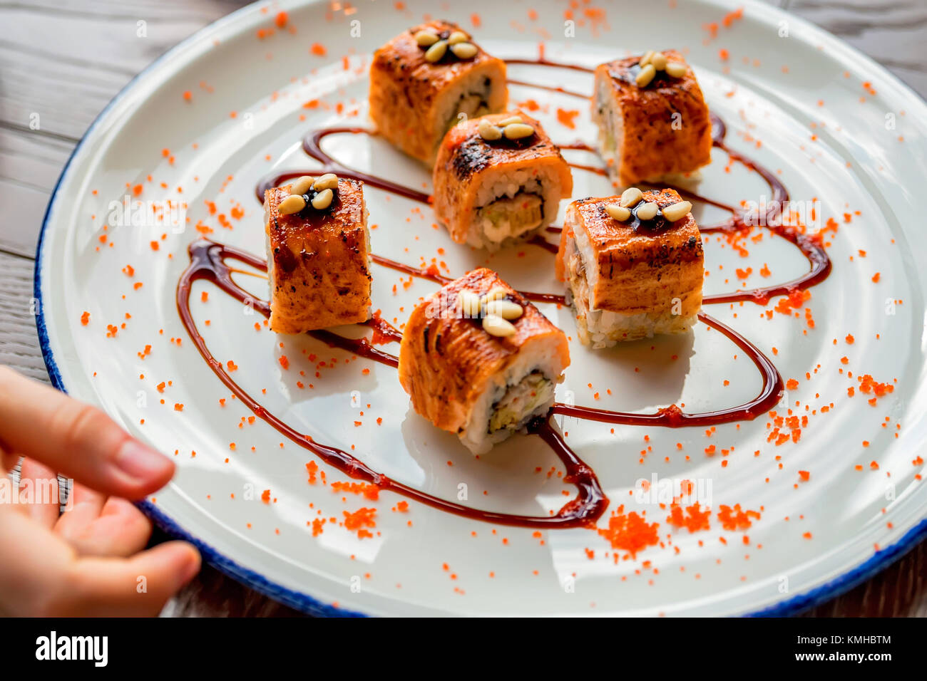 Traditional japanese sushi rolls in restaurant - Stock Image