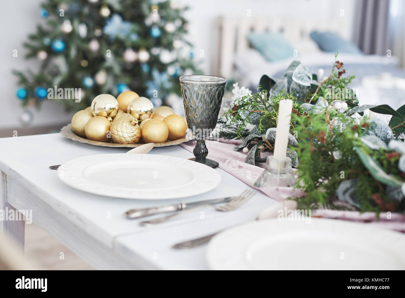 Table served for Christmas dinner in living room, close up view. - Stock Image