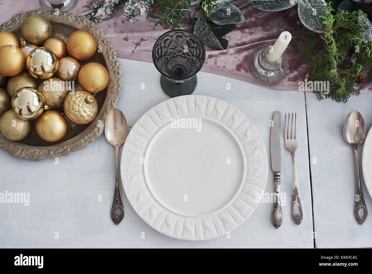 Table served for Christmas dinner in living room, top view. - Stock Image