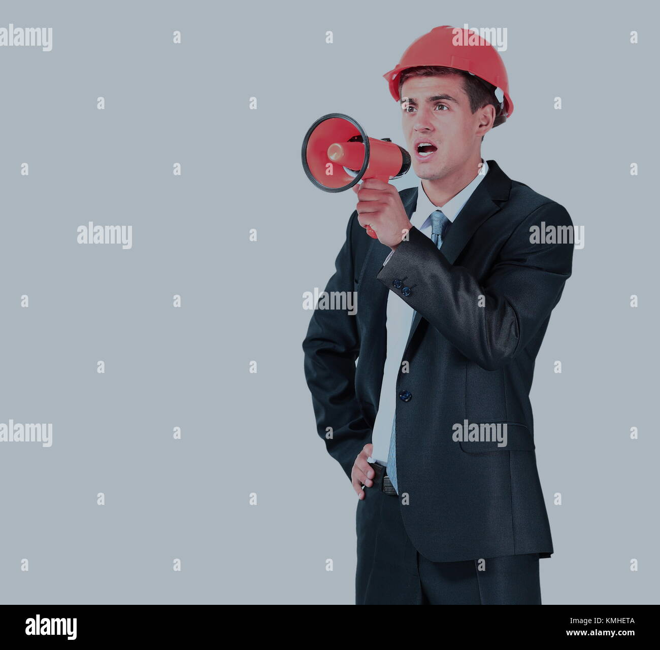 architect screaming loudly in a megaphone - Stock Image