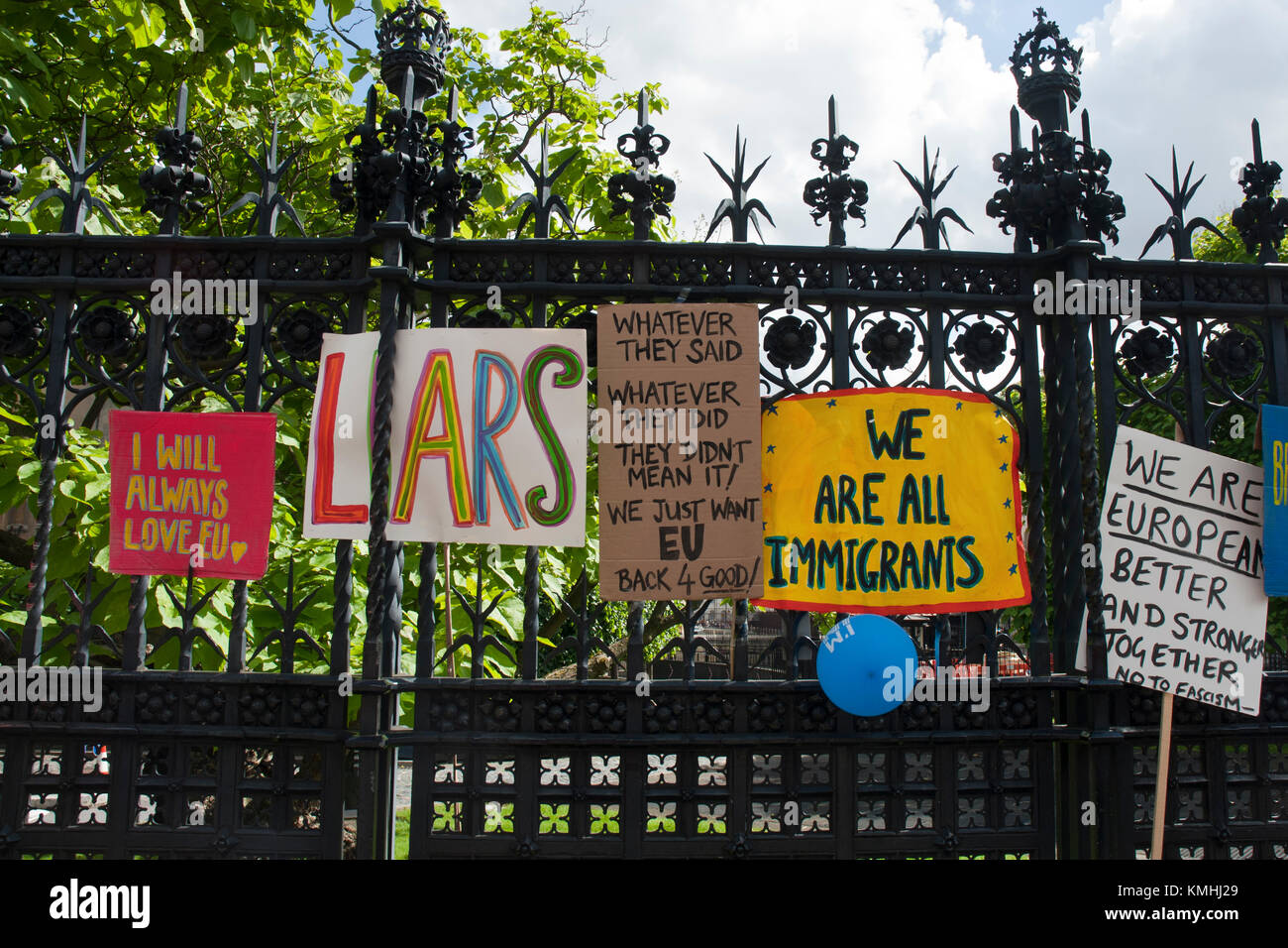 colourful anti Brexit posters stuck in the railings of Parliament, Westminster. 'I will always love EU' - Stock Image