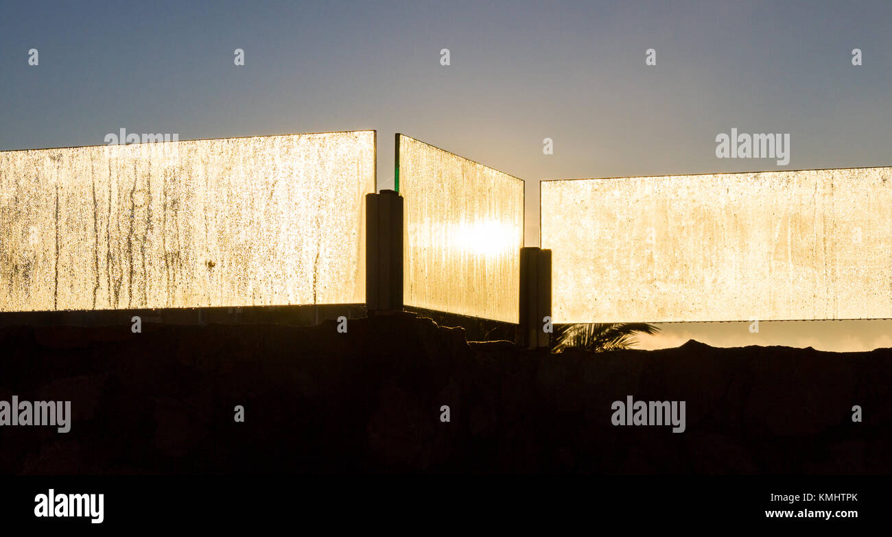 early morning condensation moisture on glass panes, backlit by sun - Stock Image