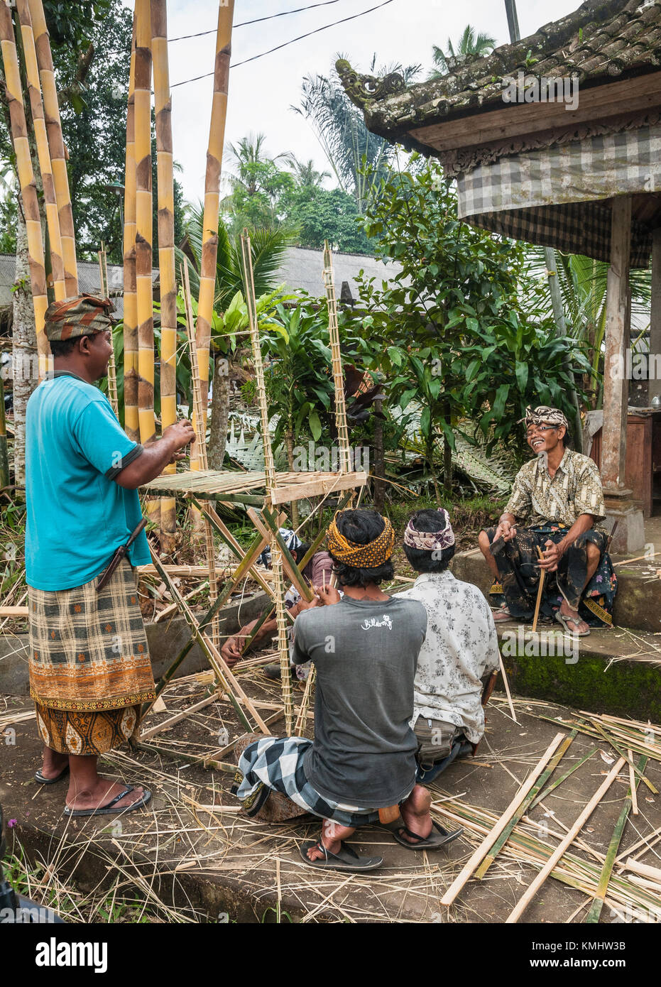 Men making biers to carry coffins at a traditional, communal cremation ritual, village of Tegalalang, Gianyar, Bali, - Stock Image