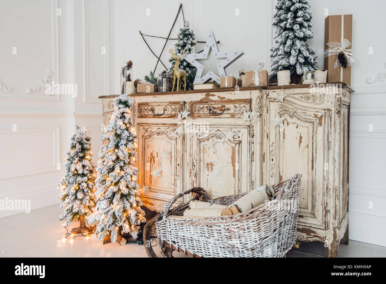 Christmas decoration on ancient vintage old commode chest of drawers ...