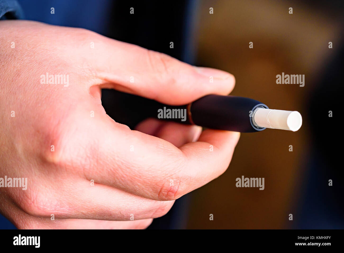 Tobacco heating system or electronoc cigarette - Stock Image