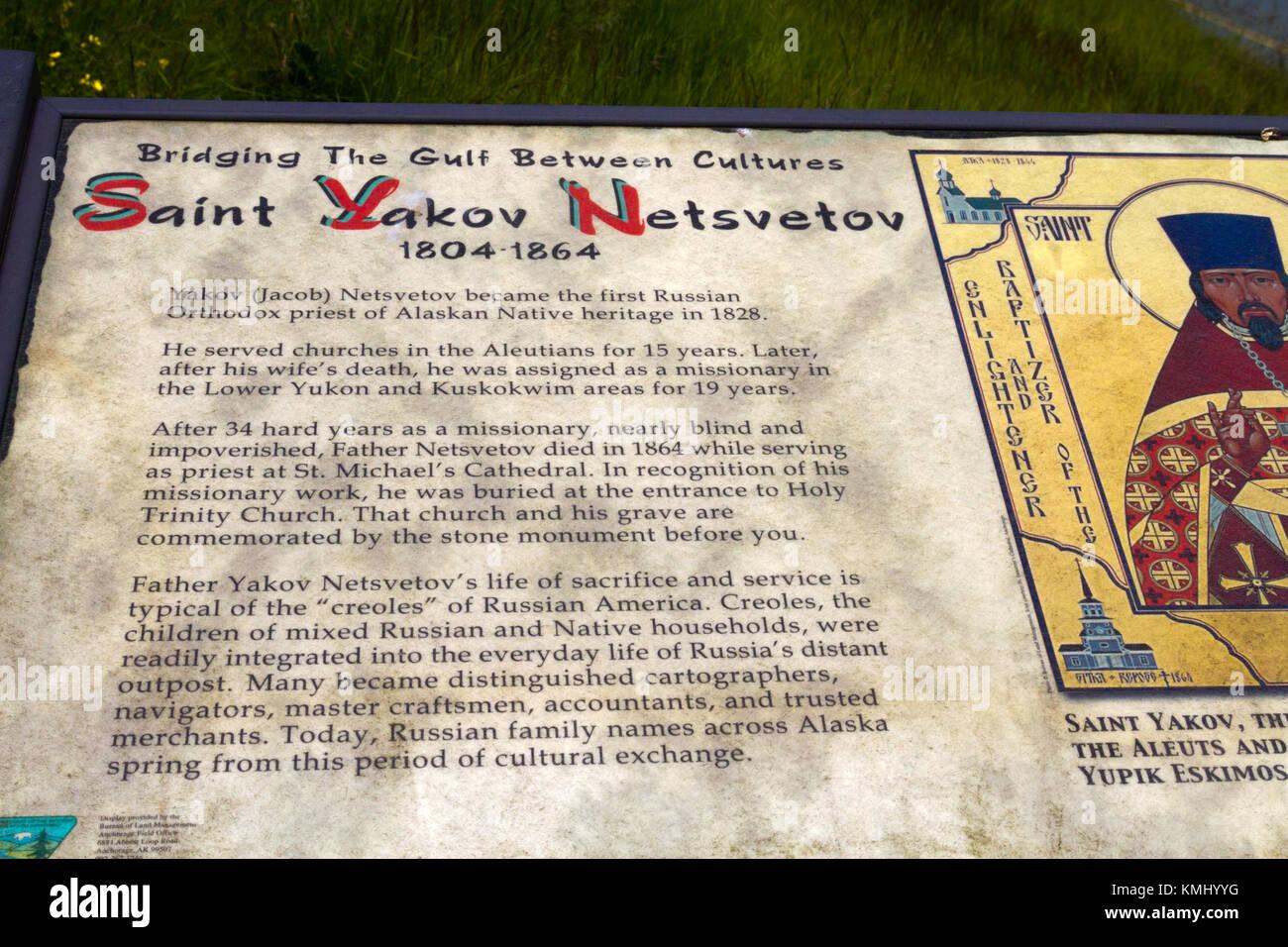 Information placard at grave site of Saint Yakov Netsevetov in Sitka, Alaska. - Stock Image