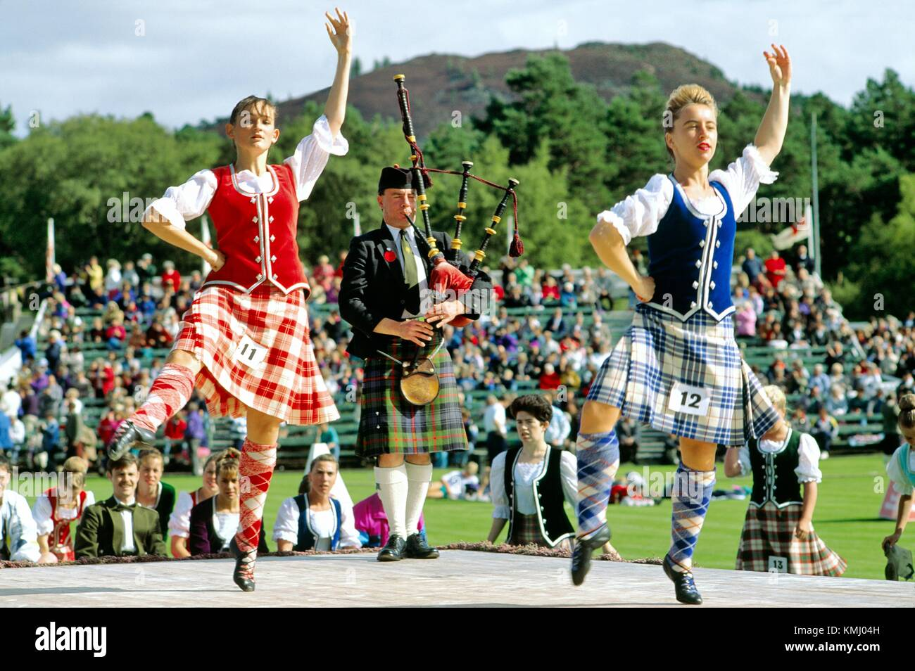 Girls at highland dancing competition contest at the annual Braemar Gathering near Balmoral in Grampian region of Stock Photo