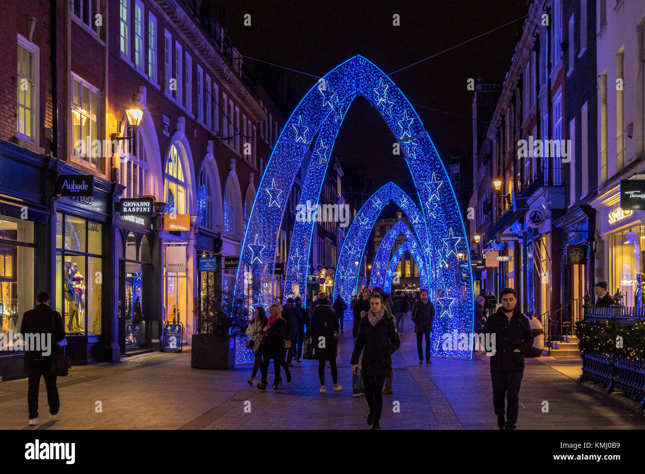 Blue Christmas Arches give a festive feel to South Molton St , London - Stock Image