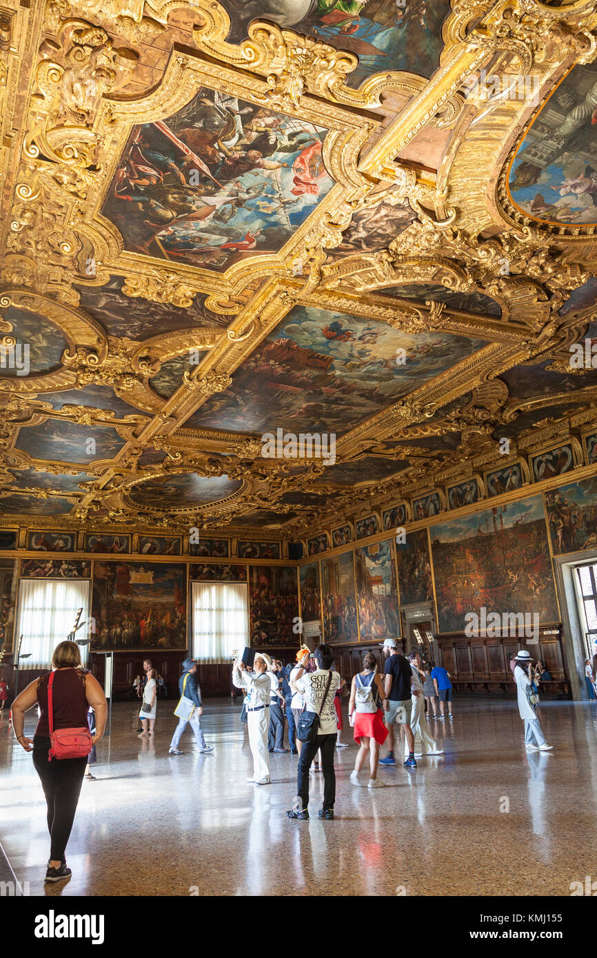 Tourists viewing the Sala del Maggior Consiglio, or Chamber of the Great Council,  in the Palazzo Ducale, Venice, - Stock Image