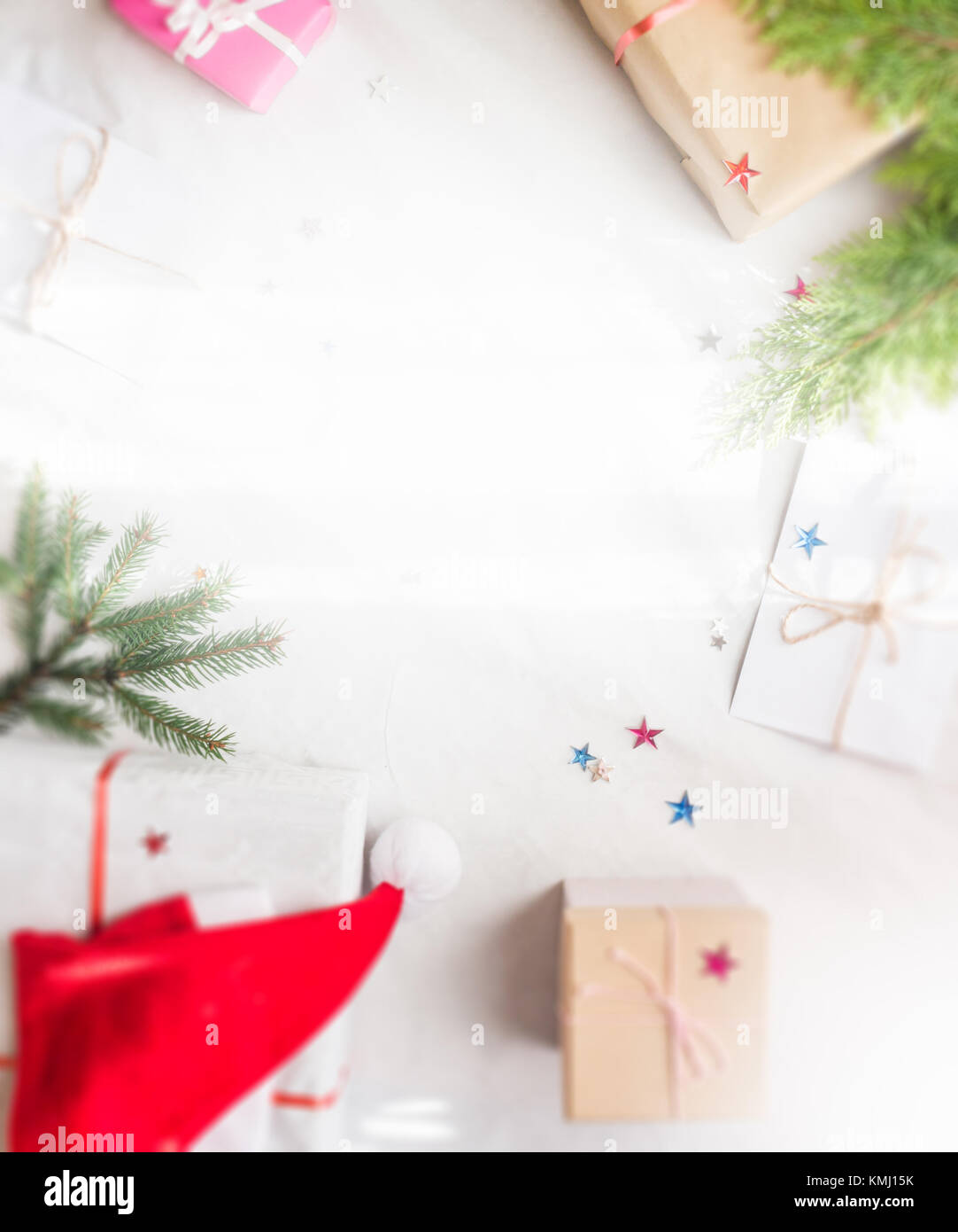 Christmas Presents Flat Lay With Branches Concept Vertical On White Background