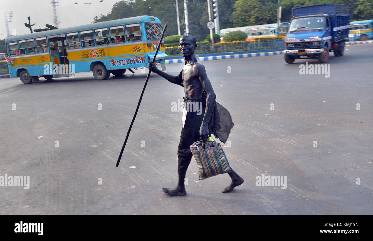 Kolkata, India. 06th Dec, 2017. A man dressed as the leader of the Indian independence movement Mahatma Mohandas - Stock Image