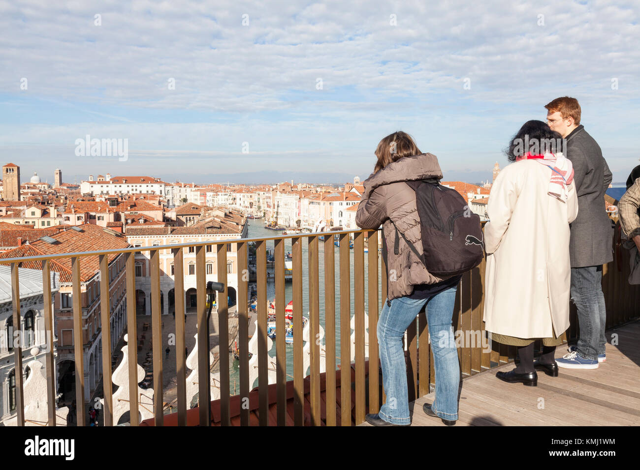 Tourists viewing the Grand Canal and rooftops of Venice from Fondaco dei Tedeschi roof terrace - Stock Image