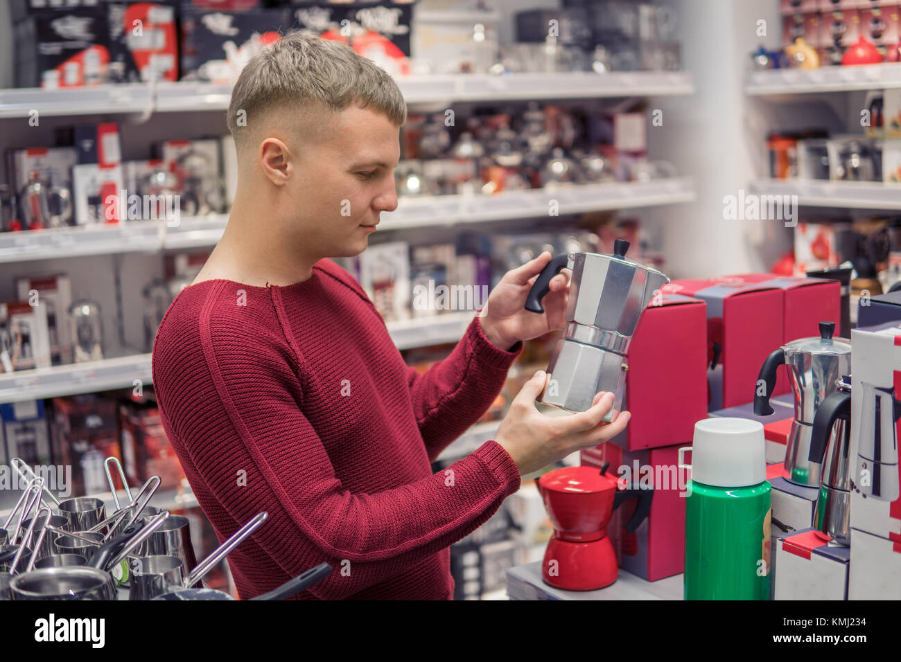 customer choosing metal Stove Top Coffee Maker - Stock Image