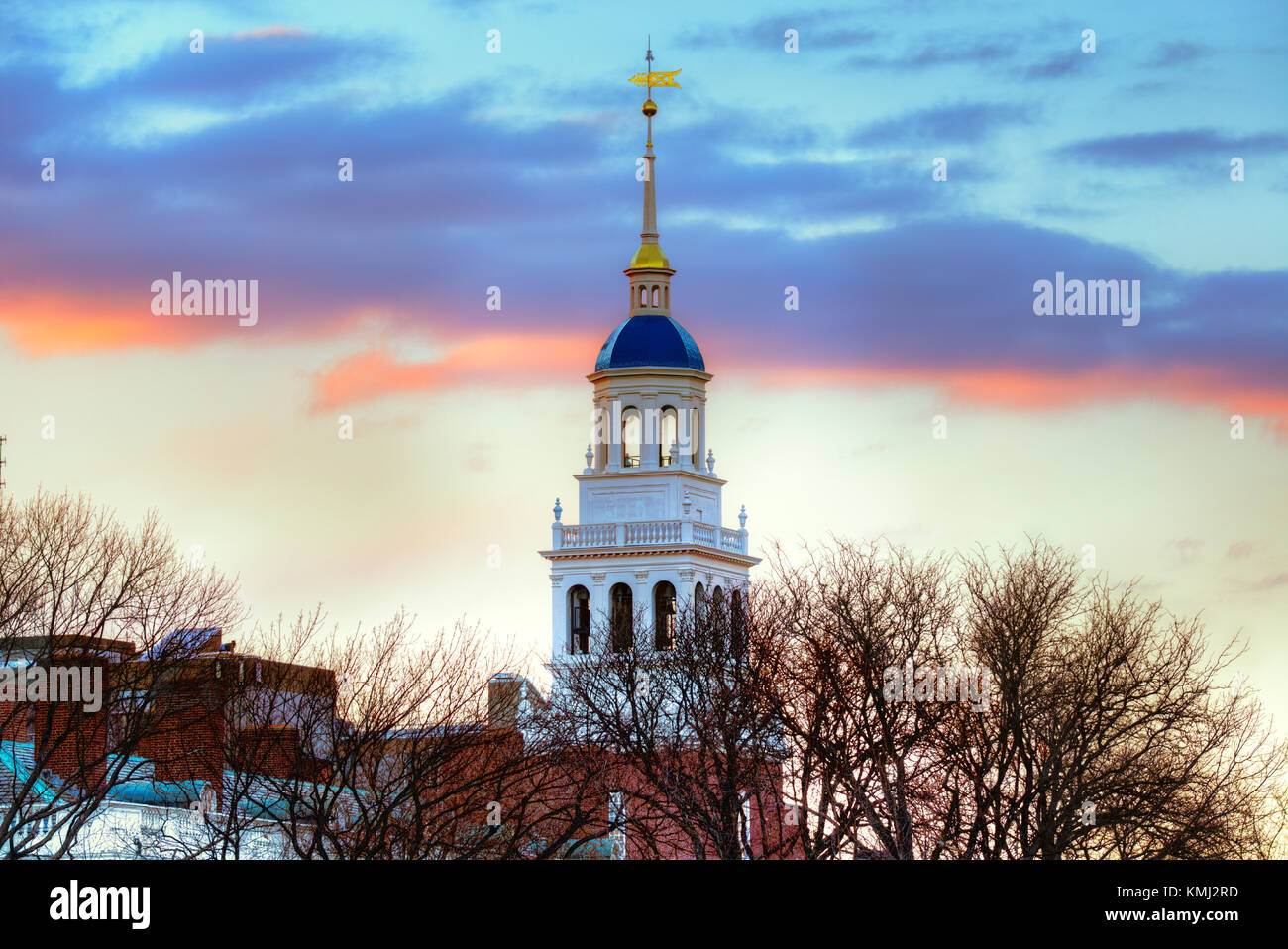 Lowell House, Harvard University. White bell tower, iconic blue dome, sunset sky, winter scene. - Stock Image