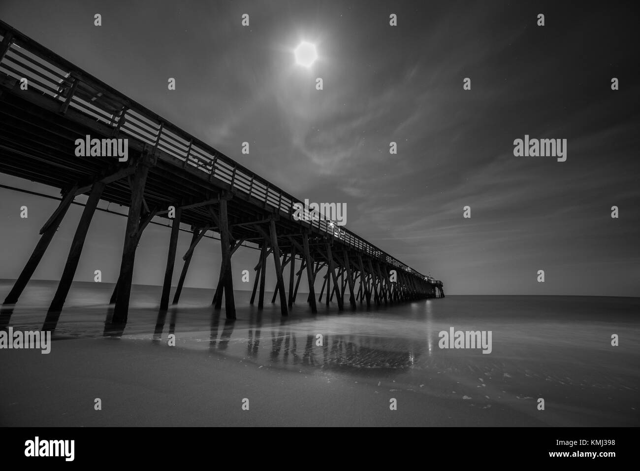 Black and white long exposure night shot of Myrtle Beach State Park pier - Stock Image