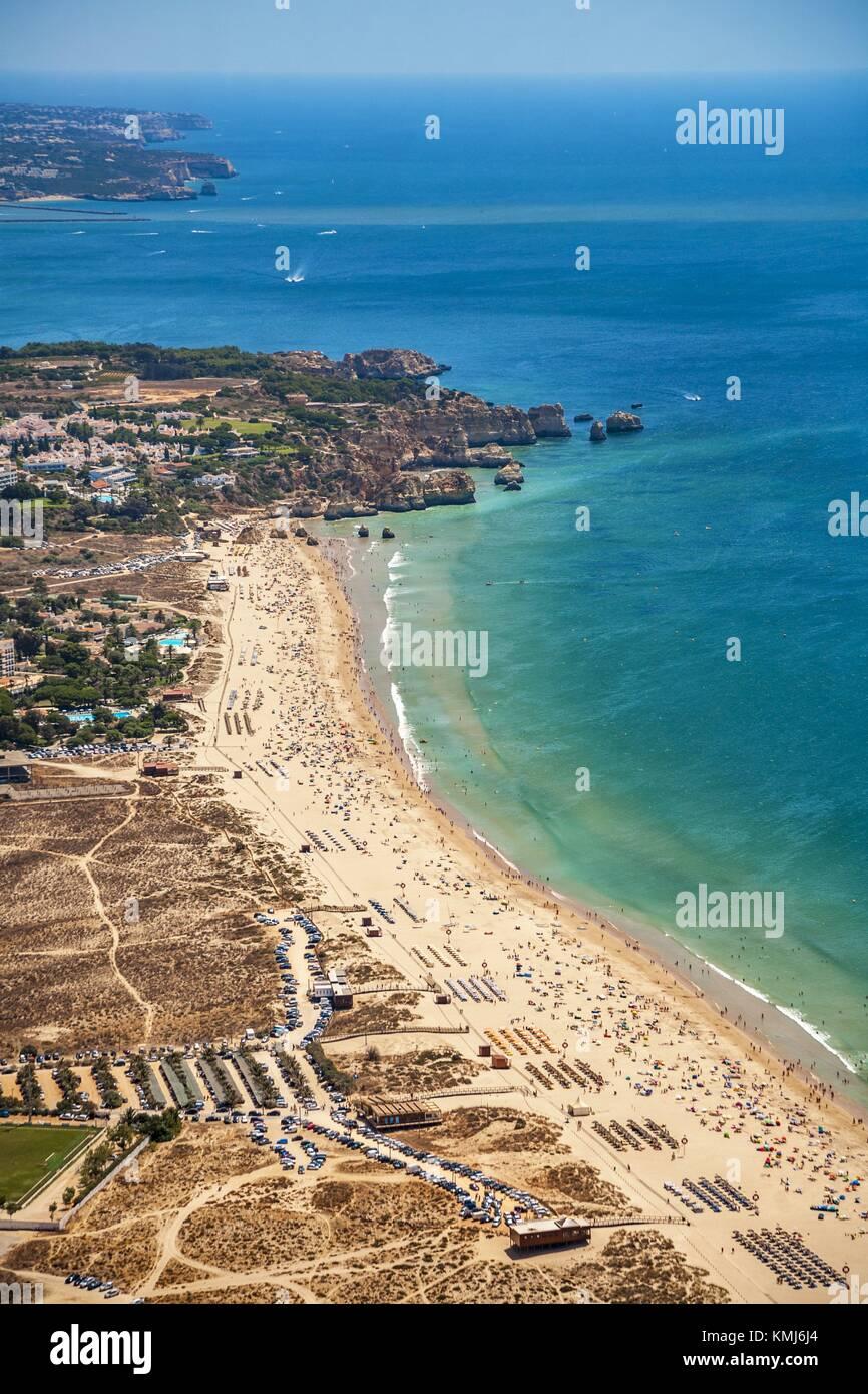 In the foreground Alvor beach. In the background Joao Arans Ponta, Tres Irmaos , Prainha beach. Faro district. Algarve, - Stock Image