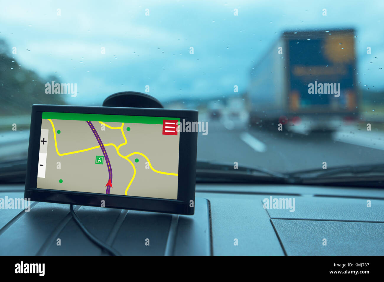 GPS (Global Positioning System) car navigation device, help and assistance with direction on road Stock Photo
