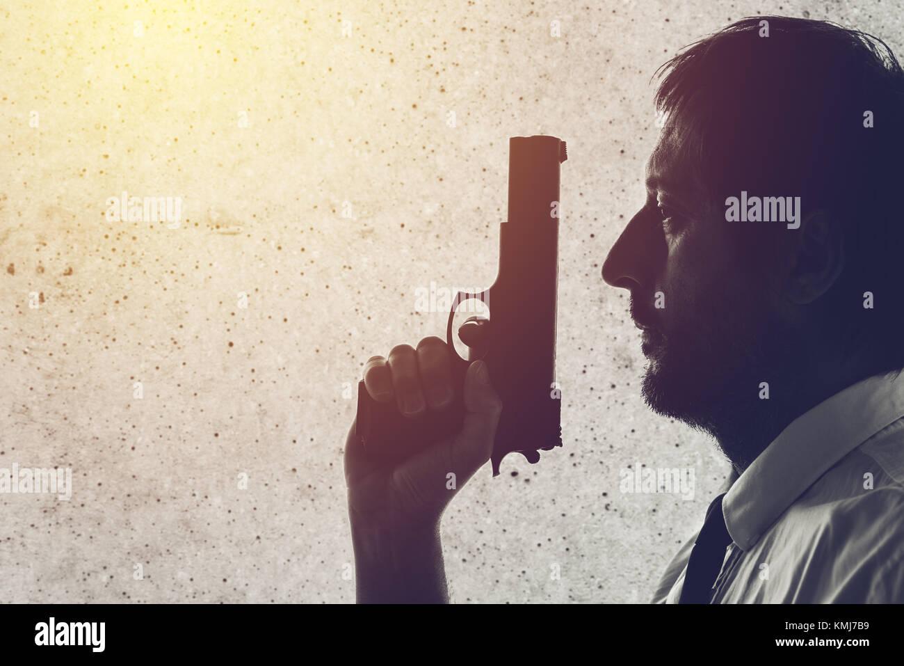 Man with a gun. Police officer, criminal investigation detective or secret service agent. Grunge edit. - Stock Image