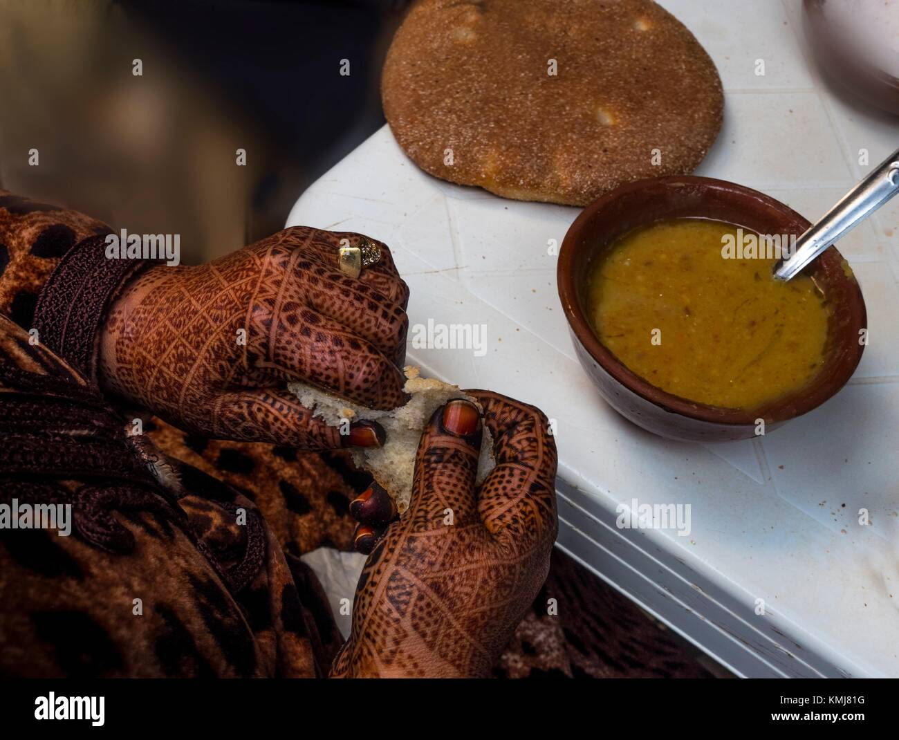 Morocco, Fes, moroccan lady with ''henna painted hands, eating ''Harira'' soup. - Stock Image
