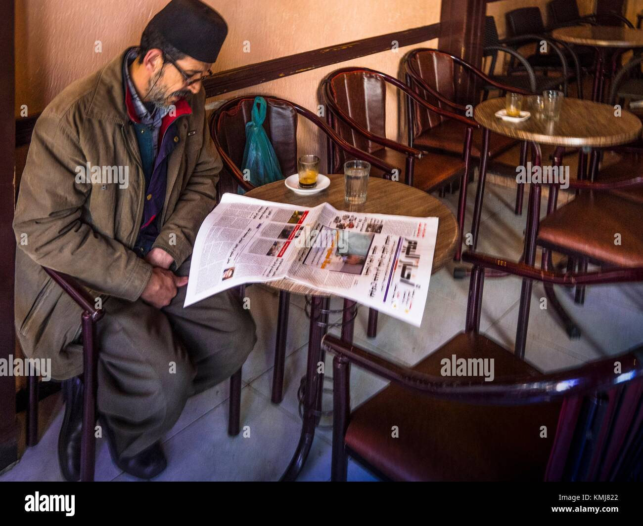 Morocco, Fes, Morning news in a Café at Fes. - Stock Image
