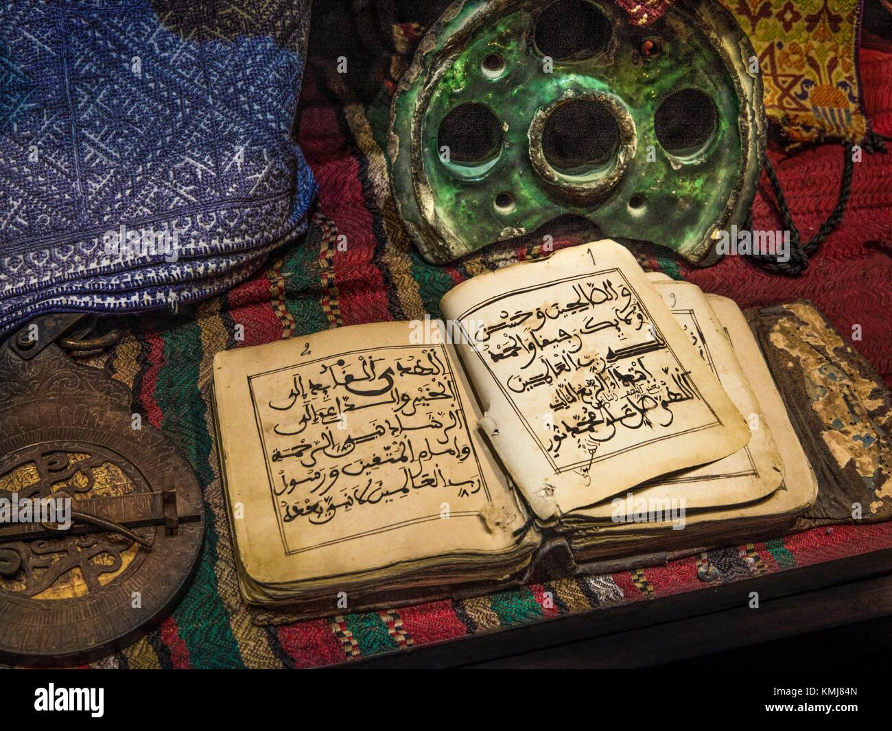 Morocco, Fes, old religious book, 18th Century, an astrolabe, an ink box, and some old pieces of textiles. - Stock Image