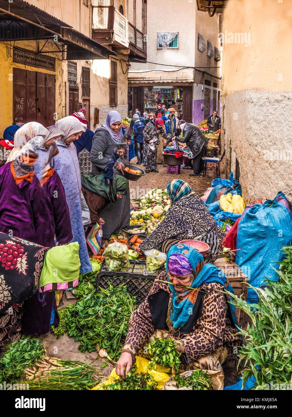 Morocco, Fes, buying vegetables in the street at Fes, Jdid. - Stock Image