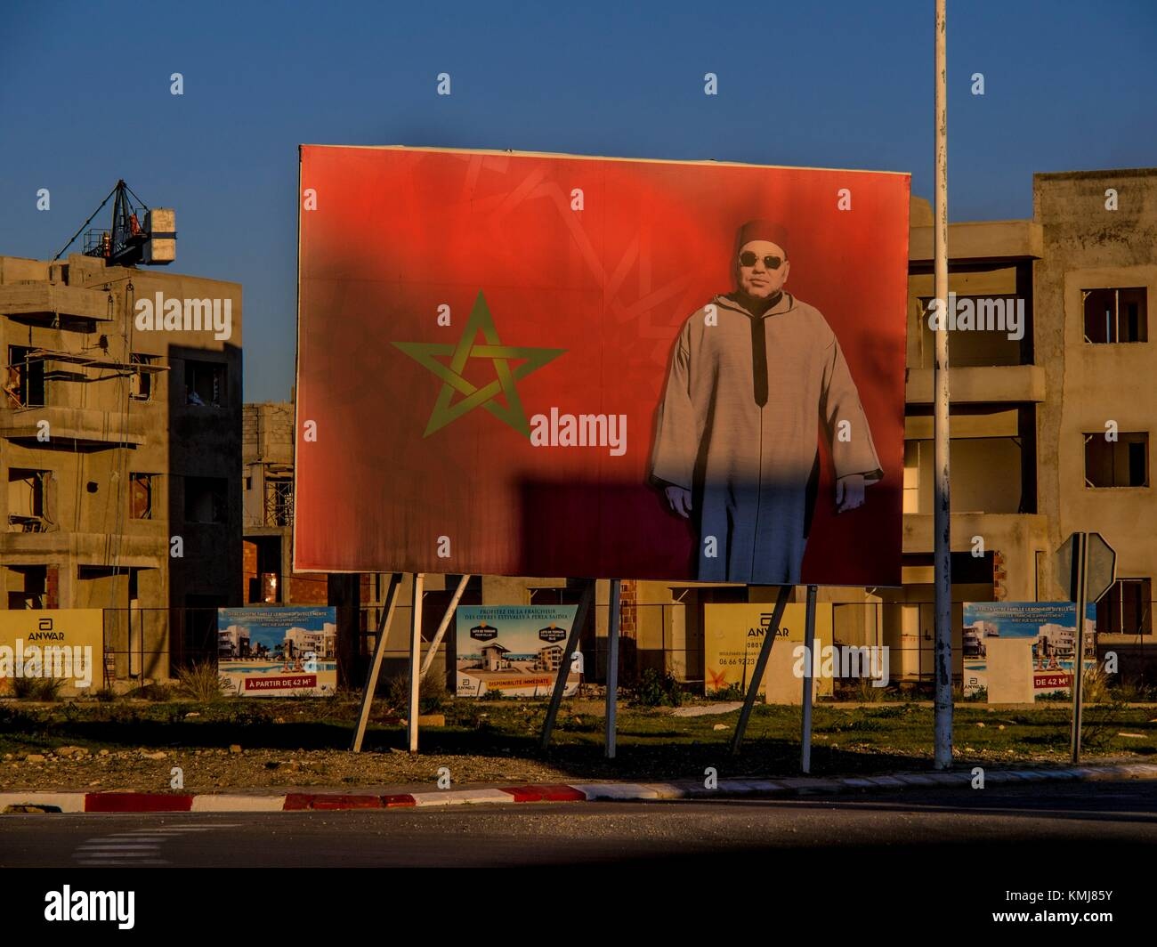 Morocco, construction boom at Saidia, with a giant picture of King Mohamed VI. - Stock Image