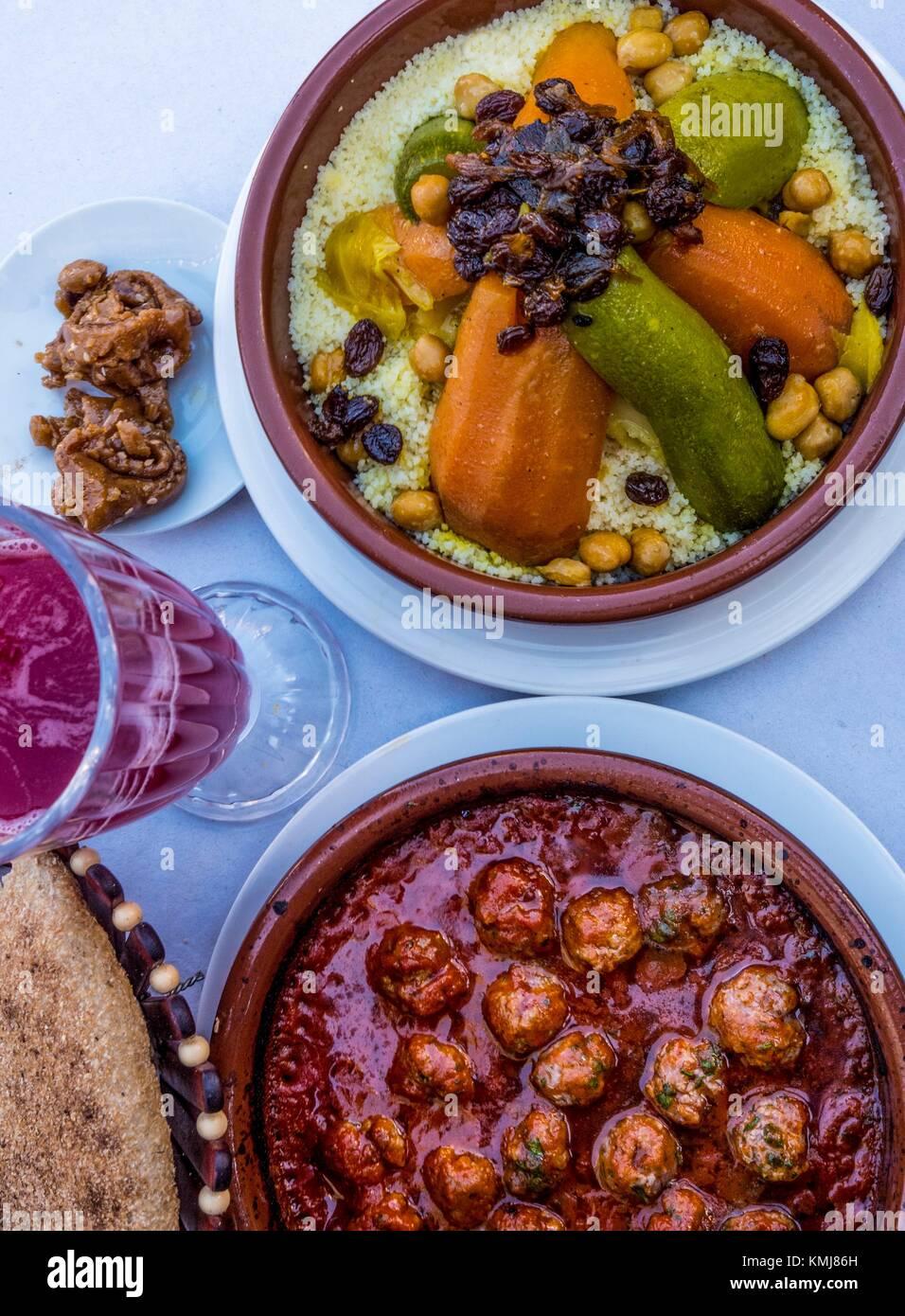 Morocco, Food, 'Kesra' bread, Pomegranate juice. 'Chebakia' sweet honney cake, 'Kefta tagine' - Stock Image