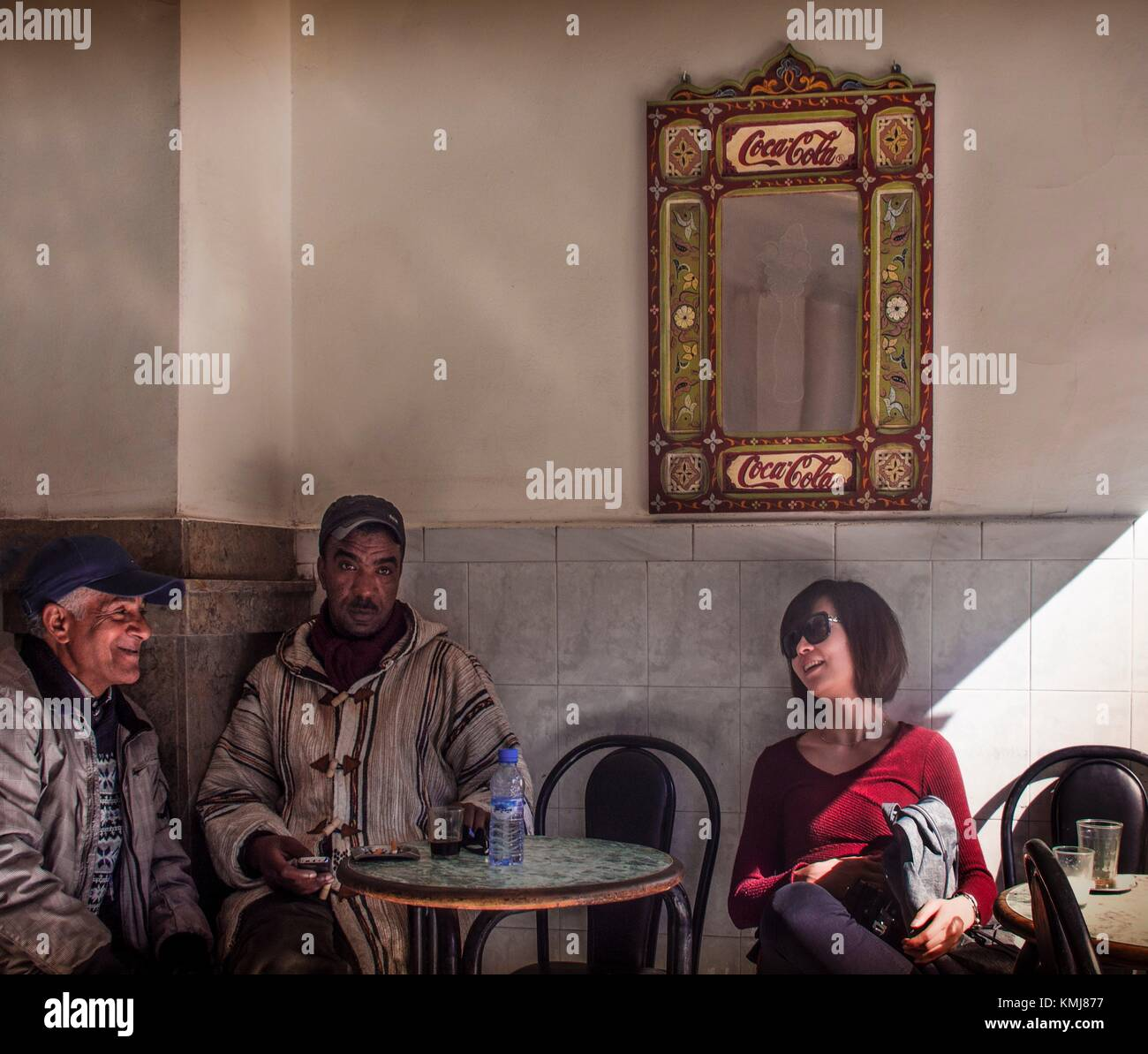 Morocco, Fes, asian tourist with moroccans at Fes. - Stock Image