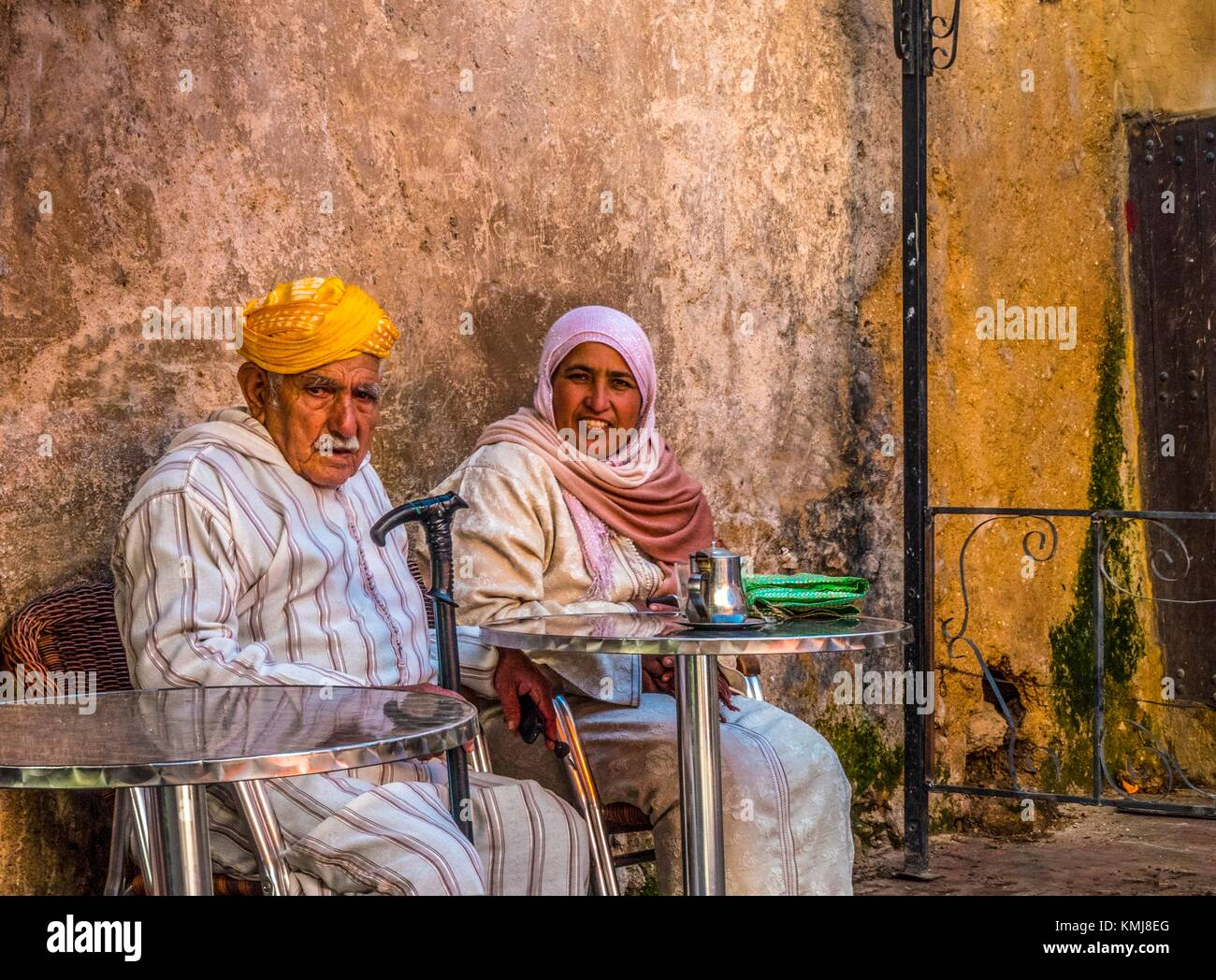 Morocco, Sefrou, older man with his younger wife having a tea,... - Stock Image