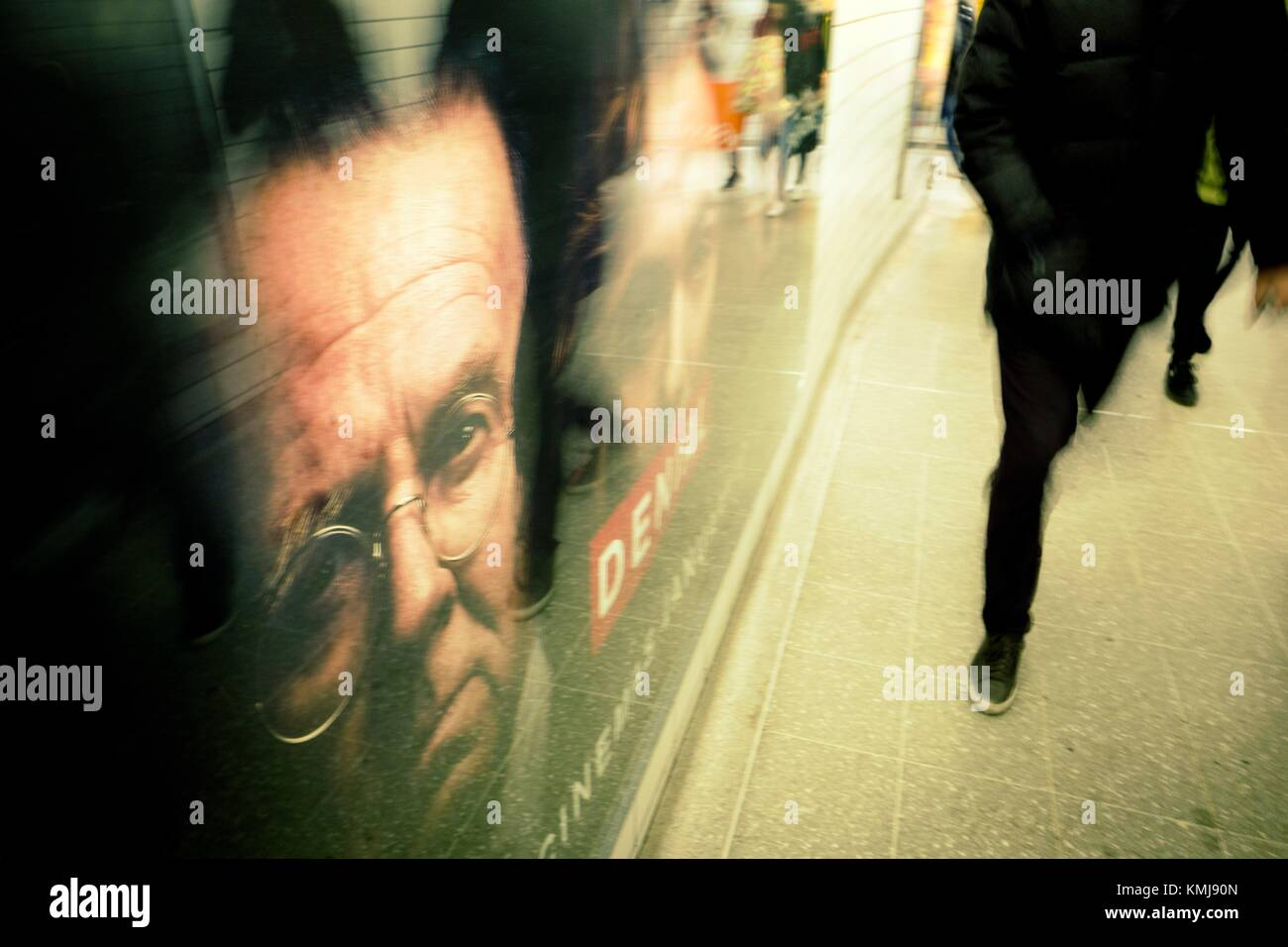 Underground corridor with people and poster of the film 'Denial'. London, England - Stock Image