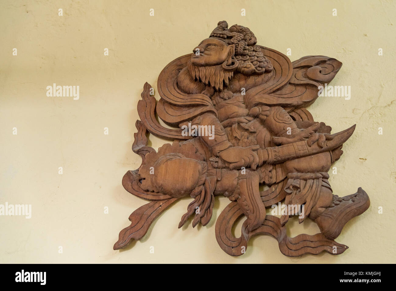 A wooden art piece of Buddhist religion. - Stock Image