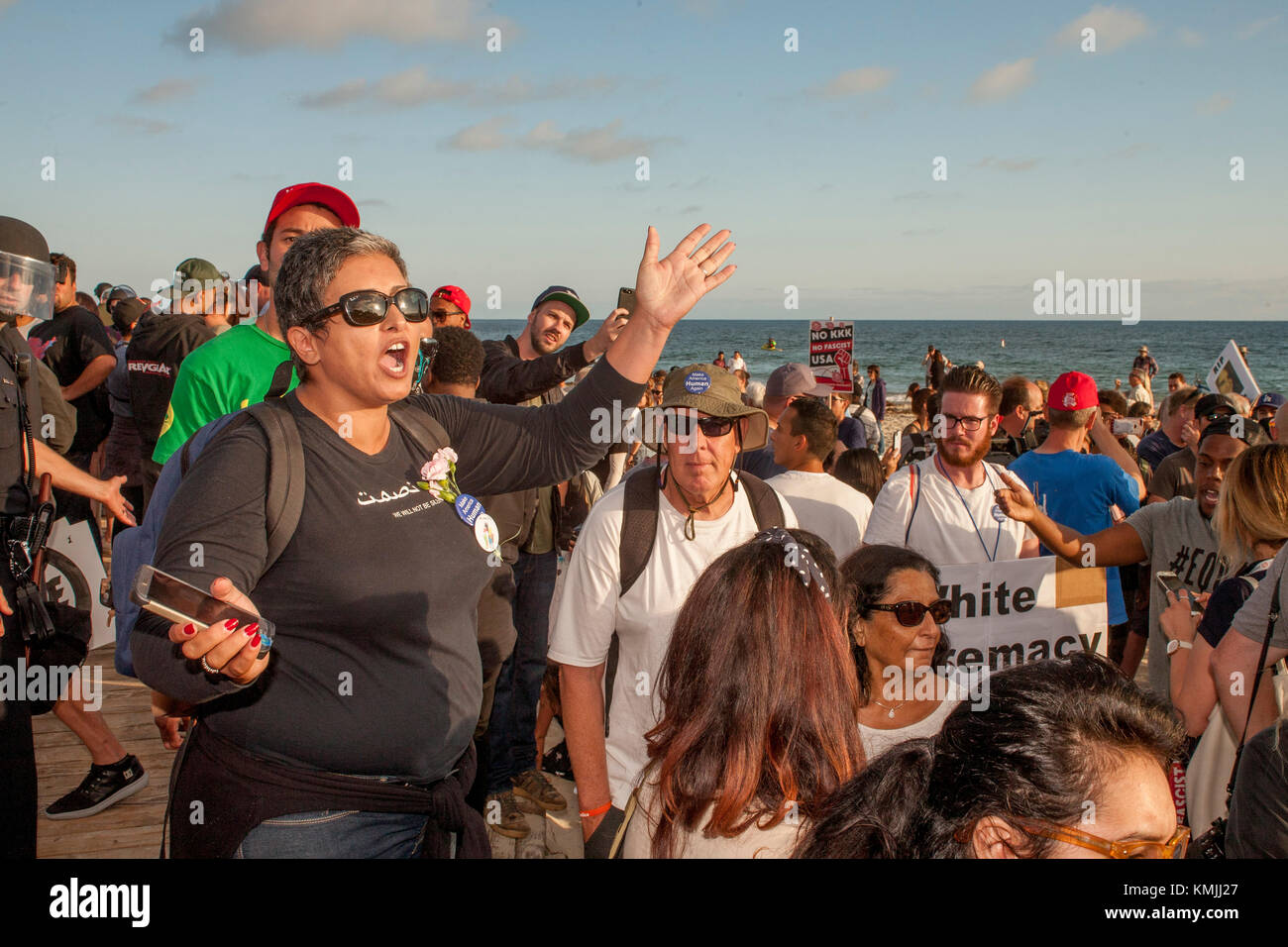Multiracial counter demonstrators express their views in Laguna Beach, CA, in opposition to an adjacent anti-immigrant - Stock Image