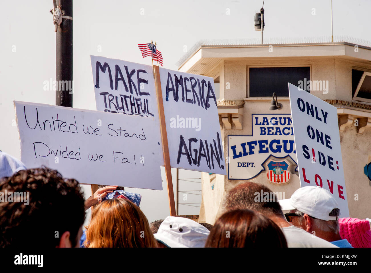 Multiracial counter demonstrators expresses toleration at an adjacent anti-immigration rally in Laguna Beach, CA. - Stock Image