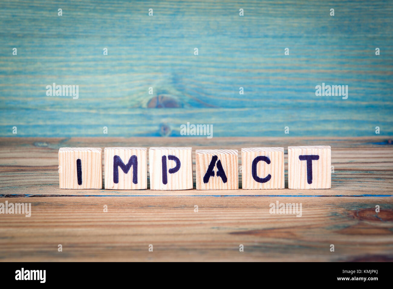impact - name from wooden letters. Office desk, informative and communication background - Stock Image