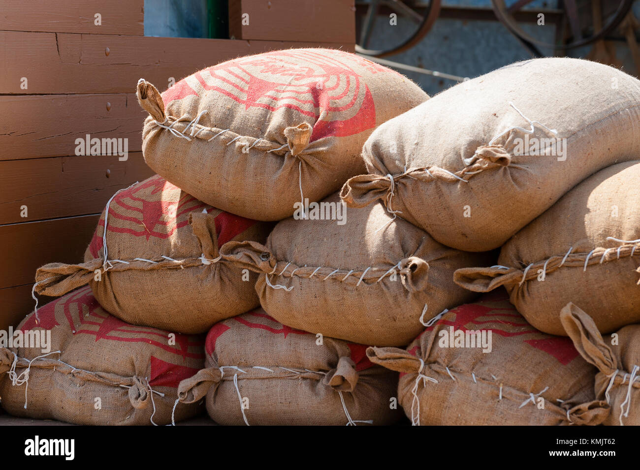 McMinnville, Oregon, USA - August 13, 2016:  Close up of hand sewn burlap sacks of grain on an old flatbed truck - Stock Image