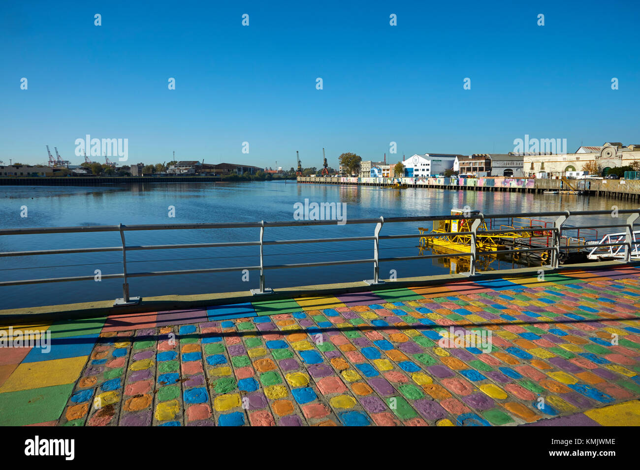 Painted cobblestones and Matanza River, La Boca, Buenos Aires, Argentina, South America - Stock Image