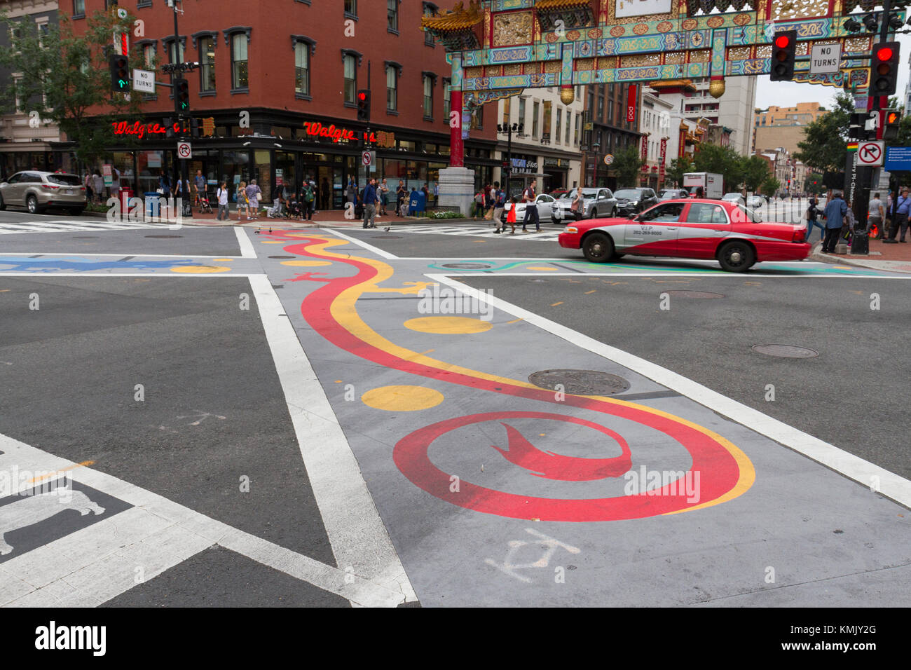 Colourful road crossing in front of the Friendship Arch in Chinatown, Washington DC, United States. - Stock Image