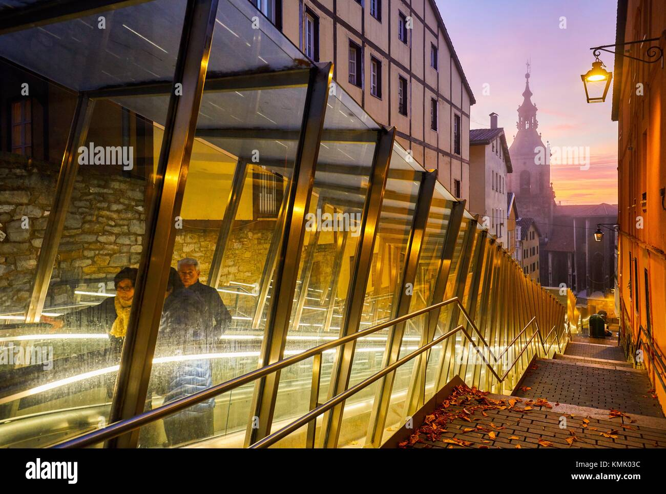 Moving walkway connecting old town with the city, San Pedro Apostol church in background, Vitoria-Gasteiz, Araba, - Stock Image