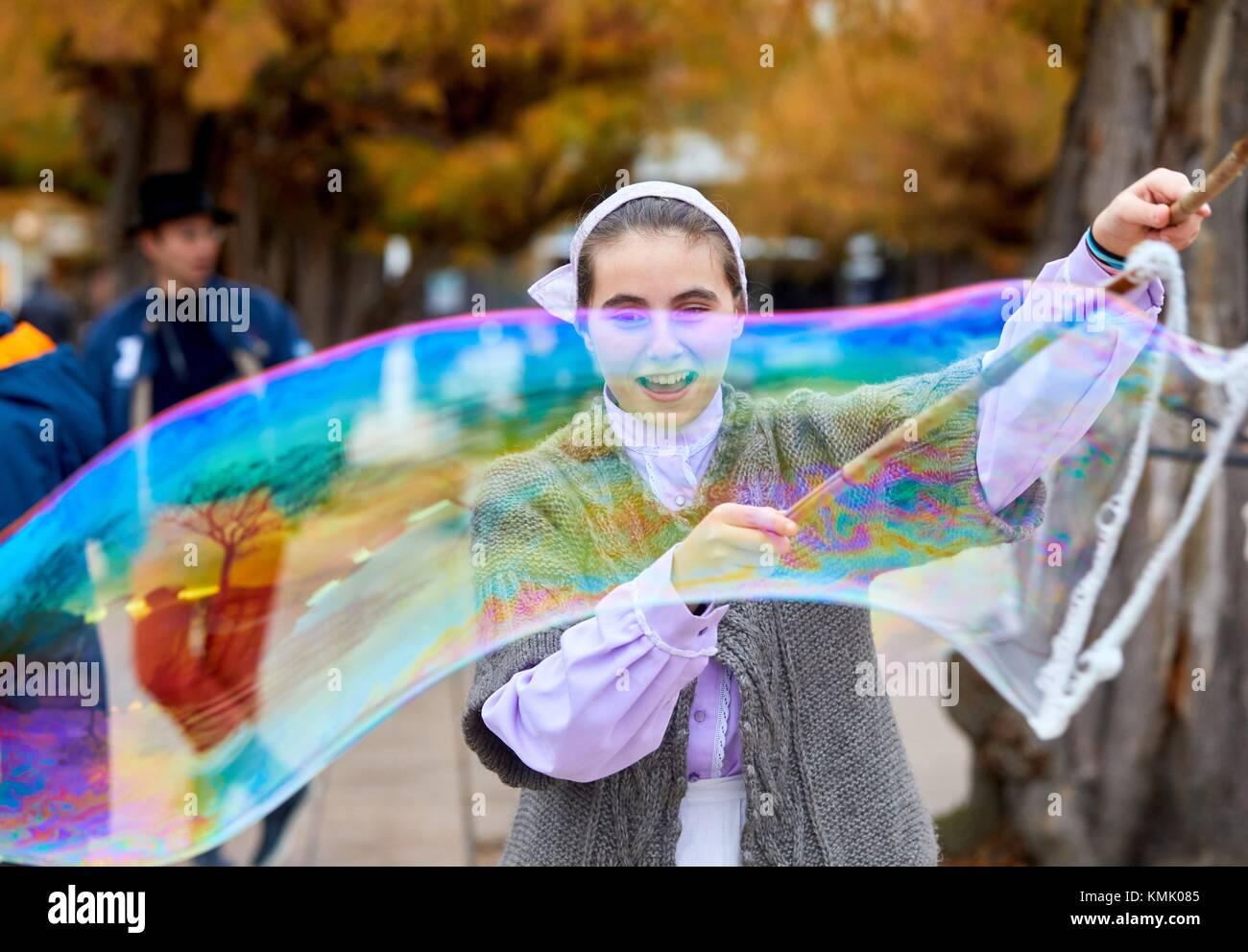 Soap bubbles, Basque regional costumes, Olentzero, Christmas, Donostia, San Sebastian, Gipuzkoa, Basque Country, - Stock Image