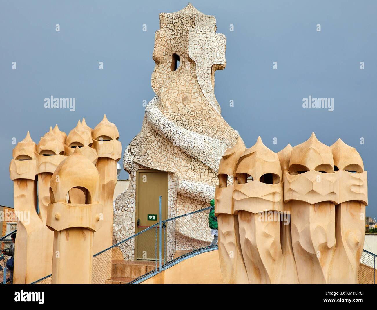 Chimneys on the rooftop of Casa Mila, La Pedrera building, Antoni Gaudi, Barcelona, Catalonia, Spain - Stock Image