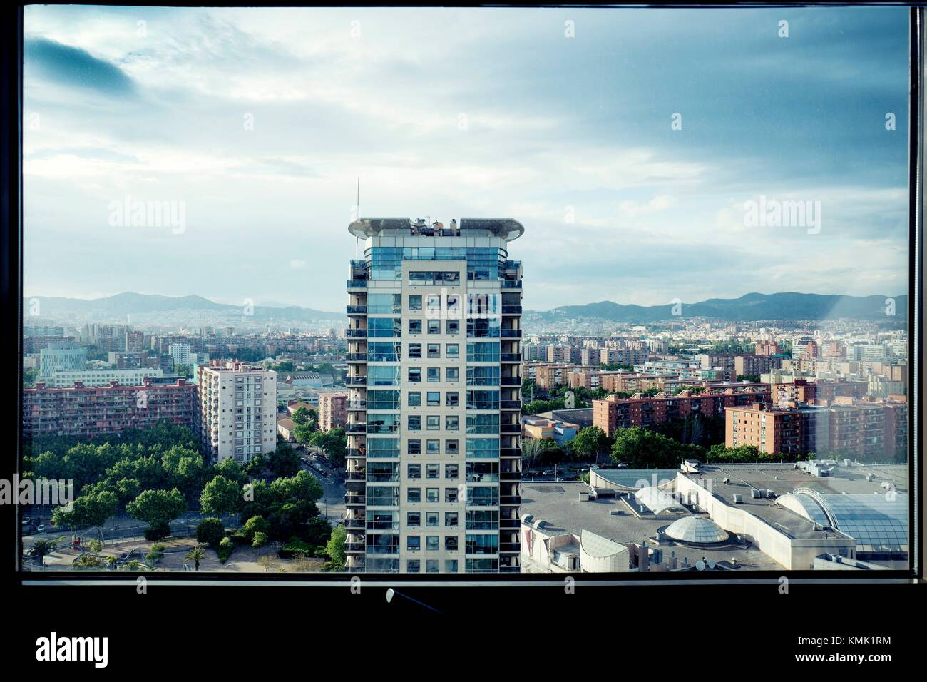 Evening view of residential tower from window. Diagonal Mar, Barcelona, Catalonia, Spain Stock Photo