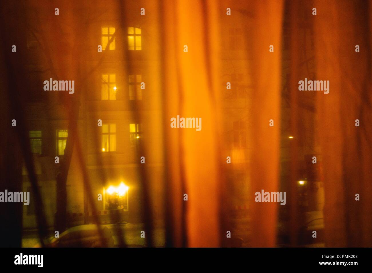 Residential building. View through curtain. Berlin, Germany - Stock Image